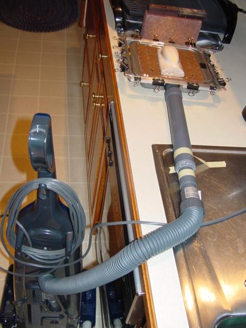 vacuum bed with vacuum source shown